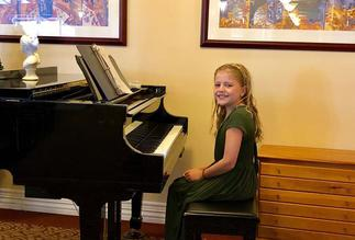 A young student performing in her first professional gig at Brookdale Assisted Living